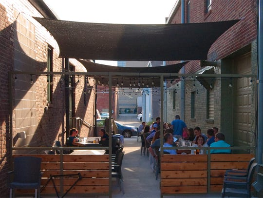 Iowa Taproom's patio sits in the alley next to the