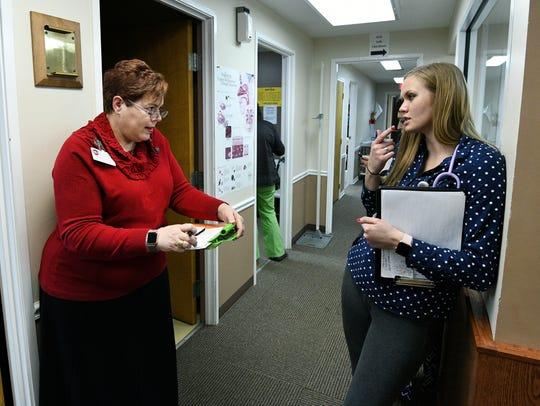 UT graduate nursing student Brooke Griffith, right,