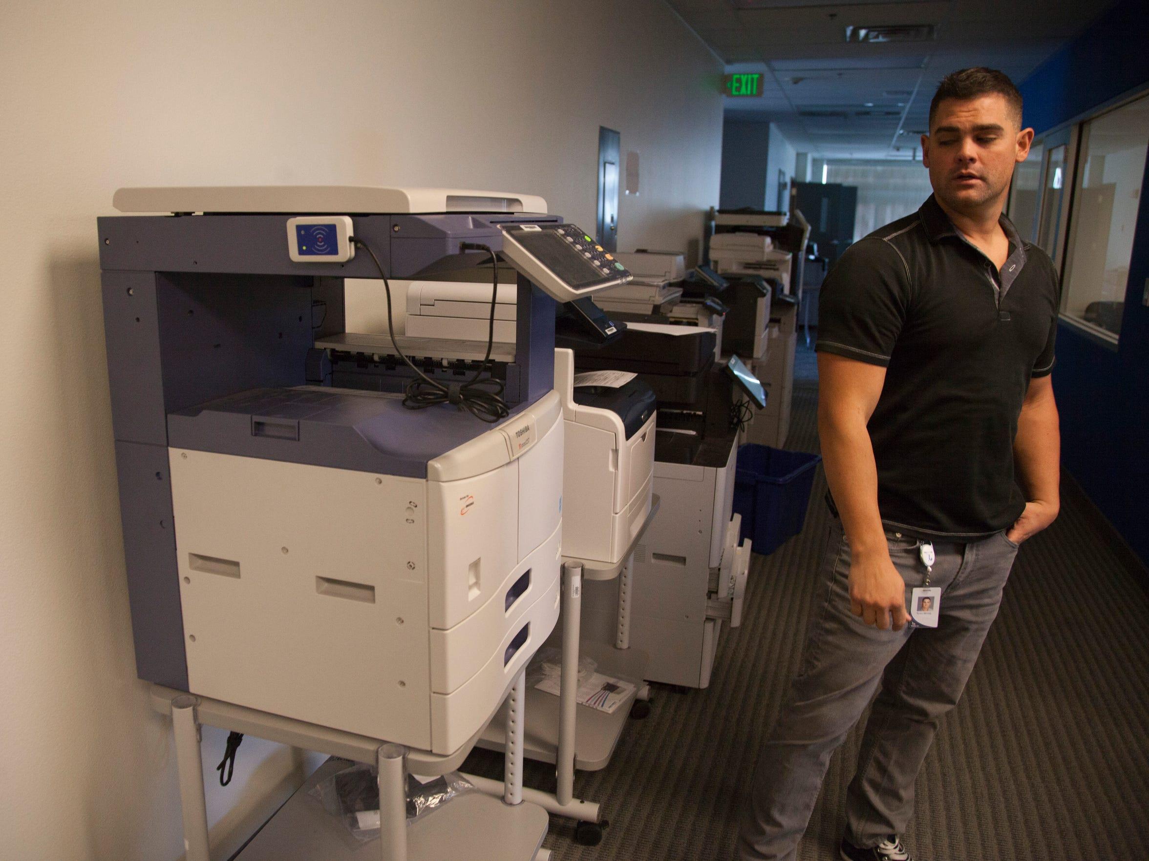 Executives at PrinterLogic, a local tech company, look