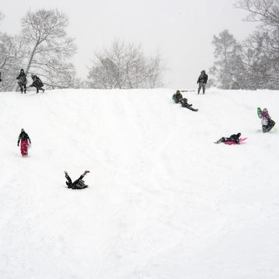 People take advantage of the snow on Reservoir Hill