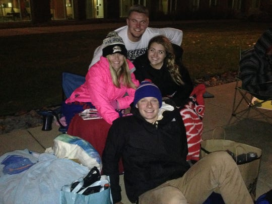 """Mitch Wilfer (back), James Calkins (front), Kristyn Lynch (left) and Taylor Gunn (right) began their """"GameDay"""" vigil at 8 p.m. on Friday."""
