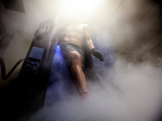 Eric Wolf, 44, of Newark walks out of the cryotherapy