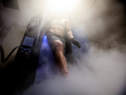 Eric Wolf, 44, of Newark walks out of the cryotherapy chamber after standing inside for several minutes. Wolf had a starting body temperature of 91 degrees and leaves the chamber with a body temperature of 61 degrees.