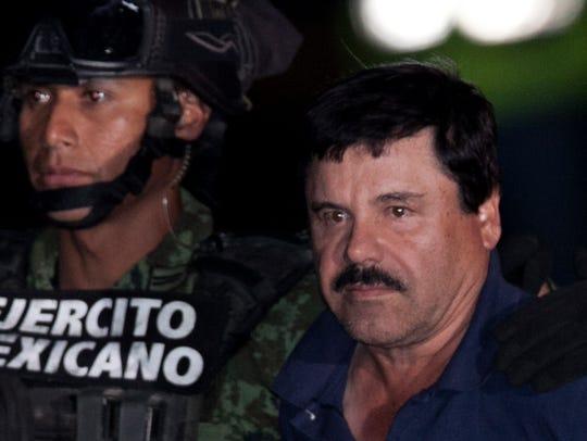"""Mexican drug lord Joaquín """"El Chapo"""" Guzmán, right,"""