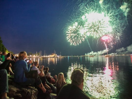 A crowd watches the fireworks on Burlington Waterfront for the Fourth of July celebration on July 3, 2015.