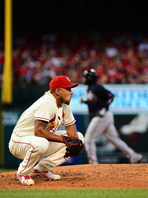 Cardinals starting pitcher Carlos Martinez (18) looks on after giving up a home run to Atlanta's Adonis Garcia (13).