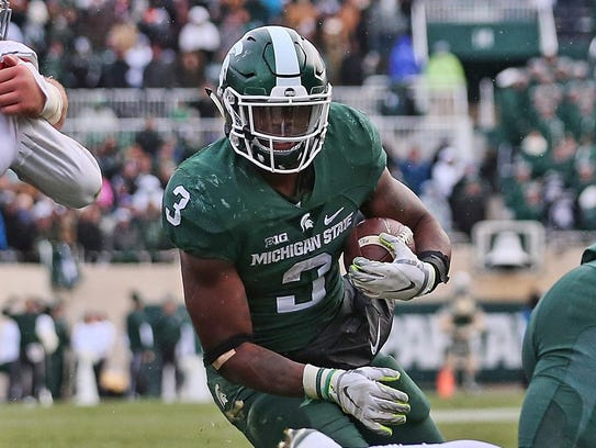 Michigan State's LJ Scott carries for the touchdown