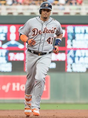 Tigers designated hitter Victor Martinez (41) rounds the bases after hitting a home run during the second inning on Friday, July 21, 2017, in Minneapolis.