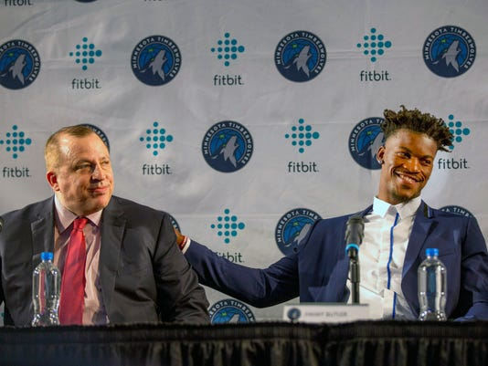 FILE - In this June 29, 2017, file photo, Minnesota Timberwolves new point guard Jimmy Butler, right, pats Timberwolves head coach Tom Thibodeau on the back during a press conference at Mall of America in Bloomington, Minn. The NBA has for years had an issue with the Western Conference being superior to the East, but next season promises to have the widest talent gap yet after a flurry of stars left their teams in the East to try to challenge the mighty Warriors in the West. (AP Photo/Andy Clayton-King, File)