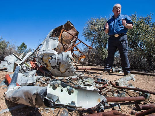 Bill Waldock, professor of Safety Science and director of the Robertson Accident Investigation Laboratory at Embry-Riddle Aeronautical University in Prescott, Ariz., talks about the remains of the crash of an R-44 helicopter.