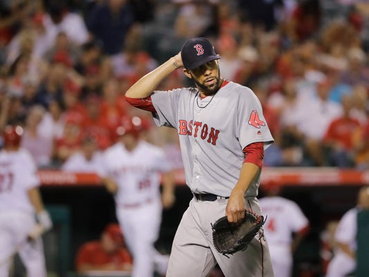 Boston Red Sox starting pitcher David Price walks off the field after the eighth inning of a baseball game against the Los Angeles Angels, Thursday, July 28, 2016, in Anaheim, Calif. (AP Photo/Jae C. Hong)