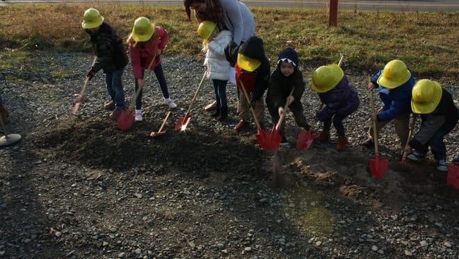 Grace Lutheran's preschool class helped break ground on the church's new building on Sunday.