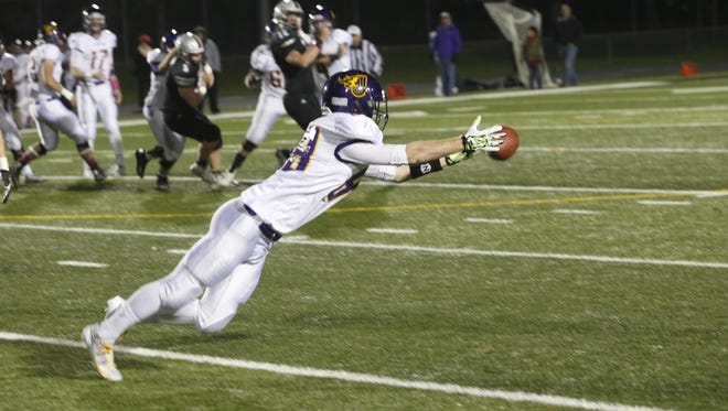 Johnston receiver Andrew Heuss tries to make a diving catch during Wednesday's Class 4-A first-round playoff game against Ankeny Centennial at Ankeny.