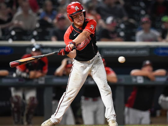 Rocori's Dalton Thelen gets a double against Mahtomedi