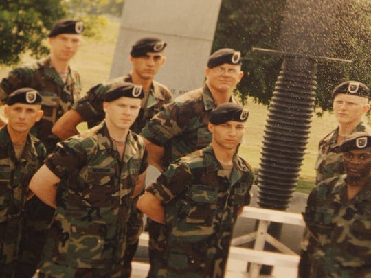Warren Davidson, pictured second from left in the bottom row, was an Army Ranger.