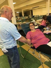 Peter Pisar, South Amboy candidate for mayor (left) thanking South Amboy resident Shirley Kubinak (right) who donated blood.