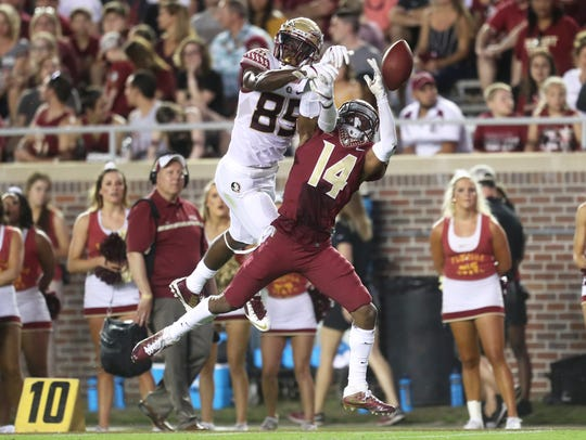FSU's Keith Gavin and Kyle Meyers battle for a ball