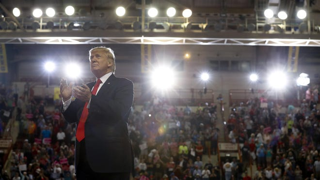 President Donald Trump turns to the audience behind him as he finishes speaking at the Pennsylvania Farm Show Complex and Expo Center in Harrisburg on Saturday, April 29, 2017. (AP Photo/Carolyn Kaster)