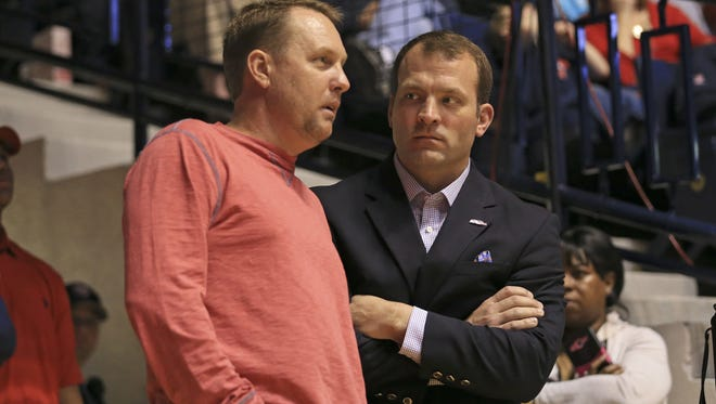 Hugh Freeze, left, and Ross Bjork spoke to Ole Miss alumni and fans in three different stops across the state Monday.
