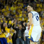 Apr 27, 2016; Oakland, CA, USA; Golden State Warriors guard Klay Thompson (11) smiles after scoring a basket against the Houston Rockets during the third quarter in game five of the first round of the NBA Playoffs at Oracle Arena. Mandatory Credit: Kelley L Cox-USA TODAY Sports