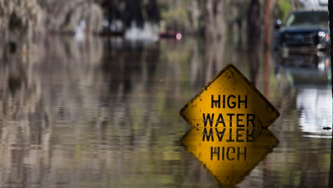 A street sign peers out from floodwater on Butler Camp Road on Lake Bistineau in Sibley, La., Monday, March 14, 2016.