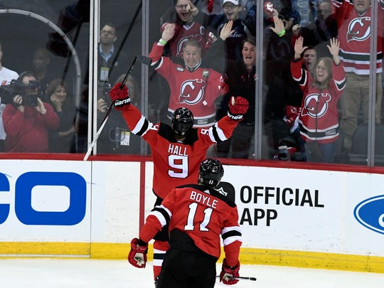 New Jersey Devils left wing Taylor Hall (9) celebrates his goal in the second period against the Tampa Bay Lightning during Game 3 of Round 1 of the Stanley Cup Playoffs at the Prudential Center in Newark, NJ on Monday, April 16, 2018.