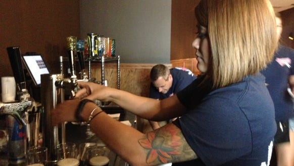 Leslie Parsons pours flights of beer at Dearborn Brewing,