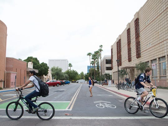 ASU Students on their bike crossing busy streets near the main campus in Tempe, Az.
