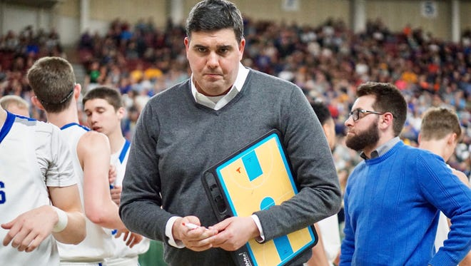 Olympic boys basketball coach Devin Huff is resigning after 11 seasons with the Trojans.