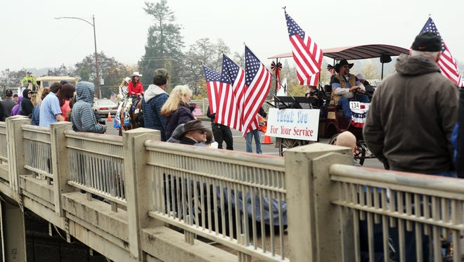 Military members and their supporters line the streets of downtown Albany for the annual Veterans Day Parade, billed as the largest of its kind west of the Mississippi River.