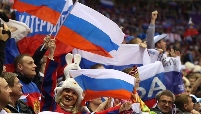 Russian fans show their support in a men's preliminary round ice hockey game /against Slovakia during the Sochi 2014 Olympic Winter Games at Bolshoy Ice Dome.