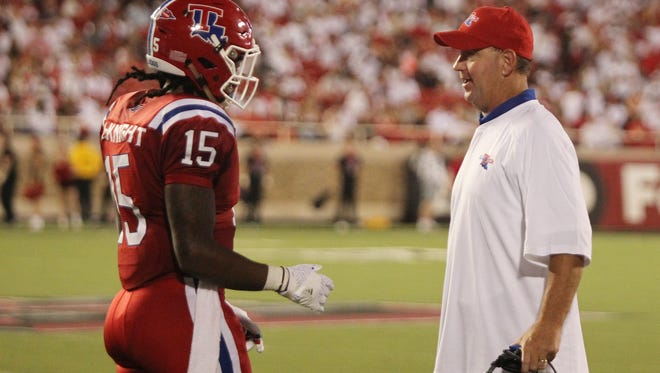 Louisiana Tech Bulldogs wide receiver Kam McKnight (15) discusses a play with head coach Skip Holtz in the second half during the game with the Texas Tech Red Raiders at Jones AT&T Stadium. Texas Tech defeated Louisiana Tech 59-45. Mandatory Credit: Michael C. Johnson-USA TODAY Sports