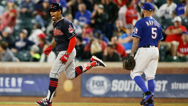 Cleveland Indians shortstop Francisco Lindor (12) rounds the bases after hitting a grand slam in the ninth inning against the Texas Rangers at Globe Life Park in Arlington. Cleveland won 9-6.