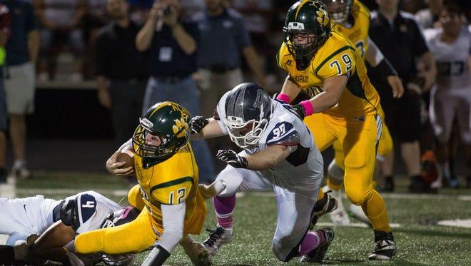 Pinnacle junior defensive tackle Kyle Van Gorp (99) sacks Horizon quarterback Dalton Sneed (12) on Oct. 23, 2014, in Scottsdale.