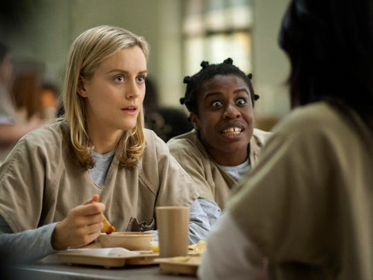 "Taylor Schilling, left, and Uzo Aduba in ""Orange Is the New Black."""