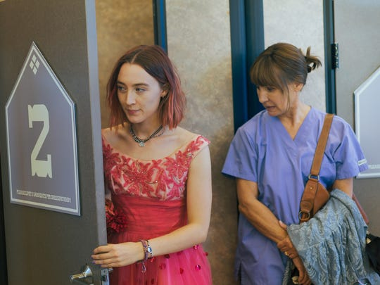Lady Bird (Saoirse Ronan, left) goes dress shopping with her opinionated mom (Laurie Metcalf) in 'Lady Bird.'