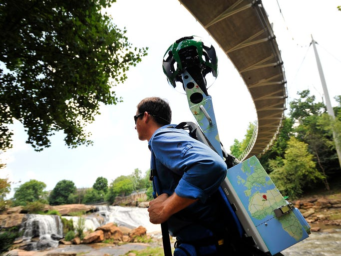 Mac Stone, a Google Maps Street View Trekker, photographs Falls Park in Greenville on Wednesday, August 20, 2014.