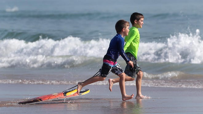 A pair of young boogie boarders make their way to the waves at Andy Romano Beachfront Park in Ormond Beach. The destination was ranked at No. 12 on TripAdvisor's list of the Top 25 beaches in the United States. It's a ranking based on traveler reviews on the website.