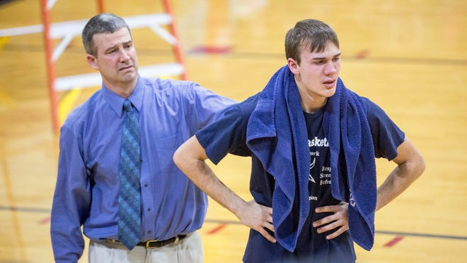 Trey Klein is comforted by his dad and coach Brian Klein after Blue River Valley lost to Seton Catholic on March 3 for the IHSAA 1A Sectional Championship. Blue River lost to Seton 59-50.