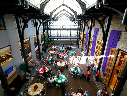 Patrons sit and eat in the main hall of First & Calvary