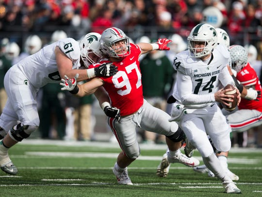 Michigan State tackle Cole Chewins tries to keep Ohio State defensive end Nick Bosa from getting to quarterback Brian Lewerke,