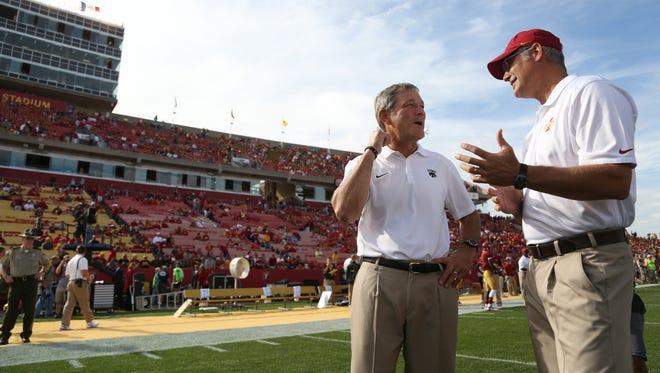 Iowa head coach Kirk Ferentz and Iowa State head coach Paul Rhoads talk before last season's game in Ames.