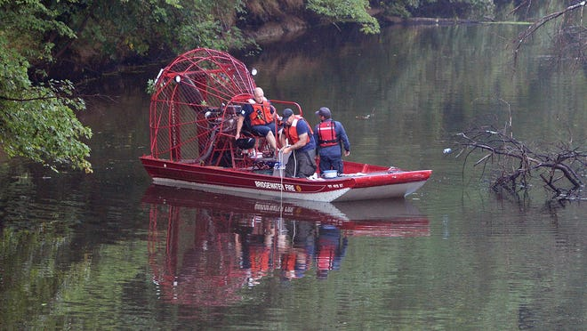 Middleboro firefighters and area dive team searching a vehicle in the Taunton River off Summer Street, Saturday, Aug. 22, 2020. The vehicle may have been there for a long time.