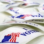 """""""I voted"""" stickers lie on a table in the Norton Shores Library in Norton Shores, Mich, Tuesday, Nov. 4, 2014."""