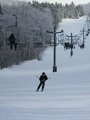 A skier speeds down a slope Thursday at Bolton Valley.