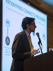 Jay Desai of PatientPing explains his company's patient-tracking software at the Sheraton Burlington Hotel and Conference Center in South Burlington on Tuesday.