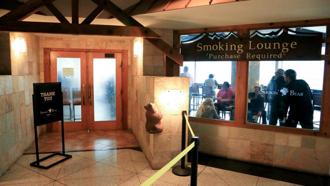 This file photo from September 2015 shows The Smokin' Bear Lodge Smoking Lounge at Denver International Airport, one of the smoking lounges that was then open at the airport.