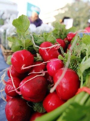 Radishes are for sale in the Gotreaux Family Farms booth at the Hub City Farmers Market. The Homegrown Speaker Series is an exploration of how local foods affect different aspects of life in Acadiana.