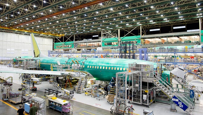 Workers at Boeing's Renton, Wash., factory build a 737NG narrowbody airplane during a factory tour on Dec. 7, 2015.