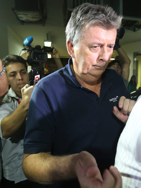 FILE - In this July 7, 2014, file photo, Ray Whelan, a longstanding director and project manager within the MATCH group, arrives at a police station after been arrested, in Rio de Janeiro, Brazil.  Whelan, a top figure in an alleged illegal World Cup ticket-scalping scheme surrendered to Brazilian officials Monday July 14, 2014, four days after police labeled him a fugitive, his lawyer said. (AP Photo/Str, file)